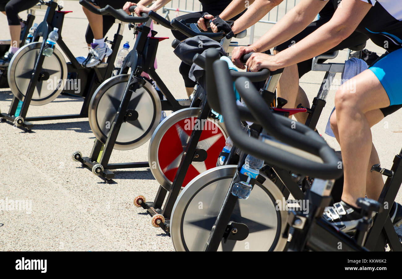 Legs moving during a workout of spinning-----Imperia, IM, Italy - May 18, 2014: People perform a spinning session - Stock Image