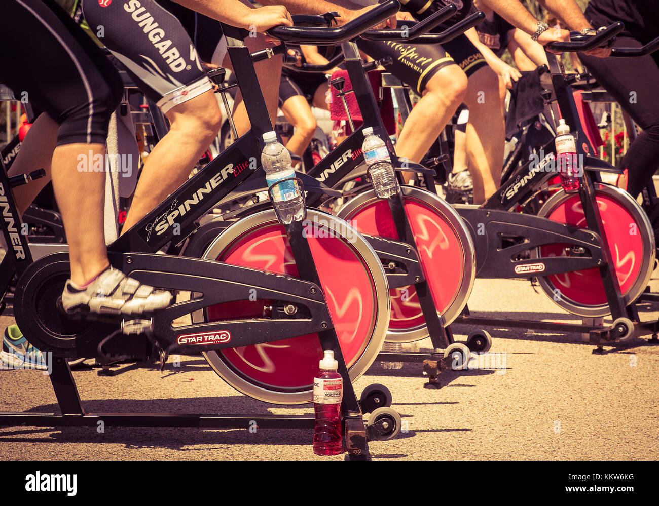 Legs moving during a workout of spinning. ----- Imperia, IM, Italy - May 18, 2014: People perform a spinning session - Stock Image