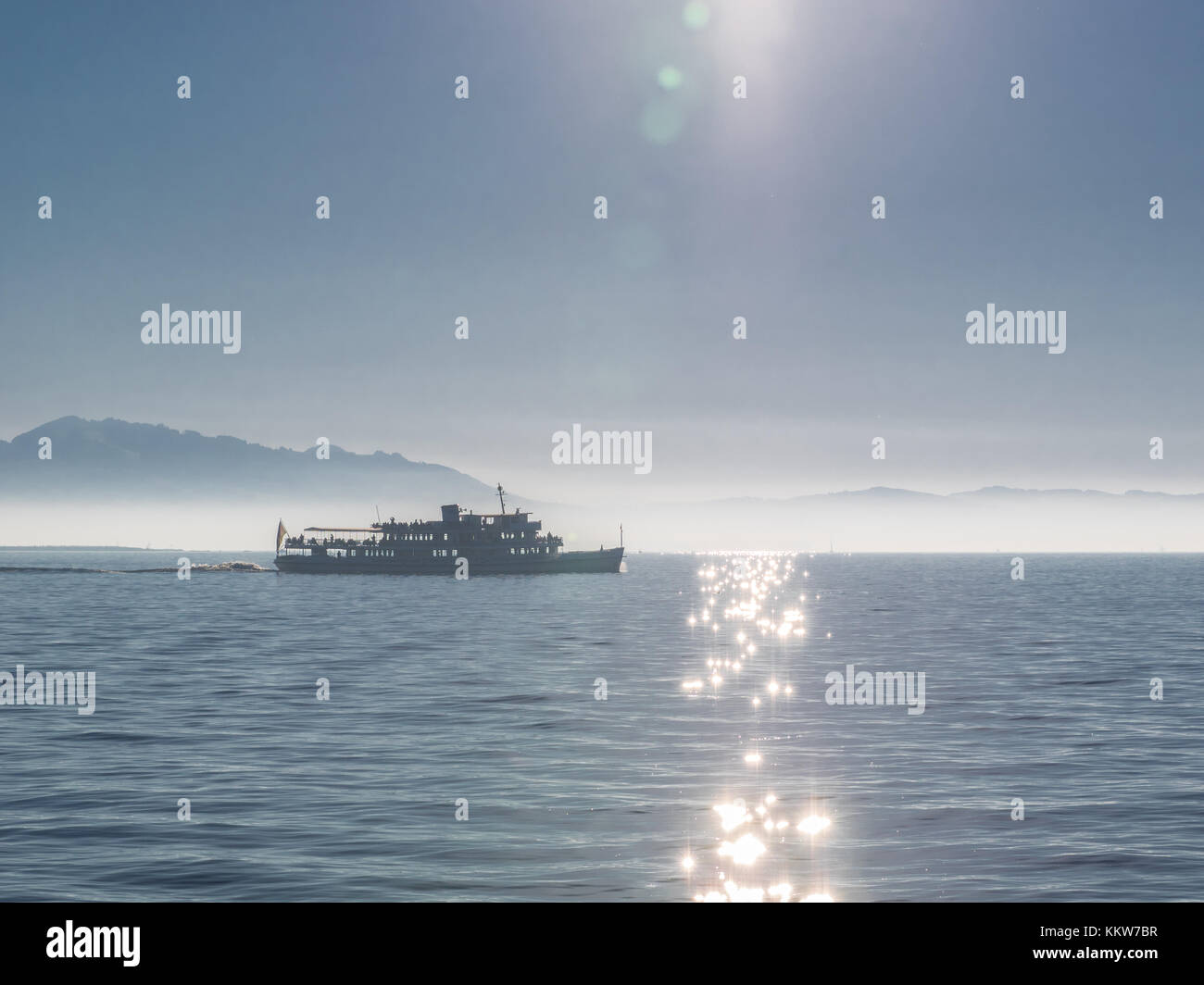 Ferry transporting passengers over lake constance on a sunny day - Stock Image