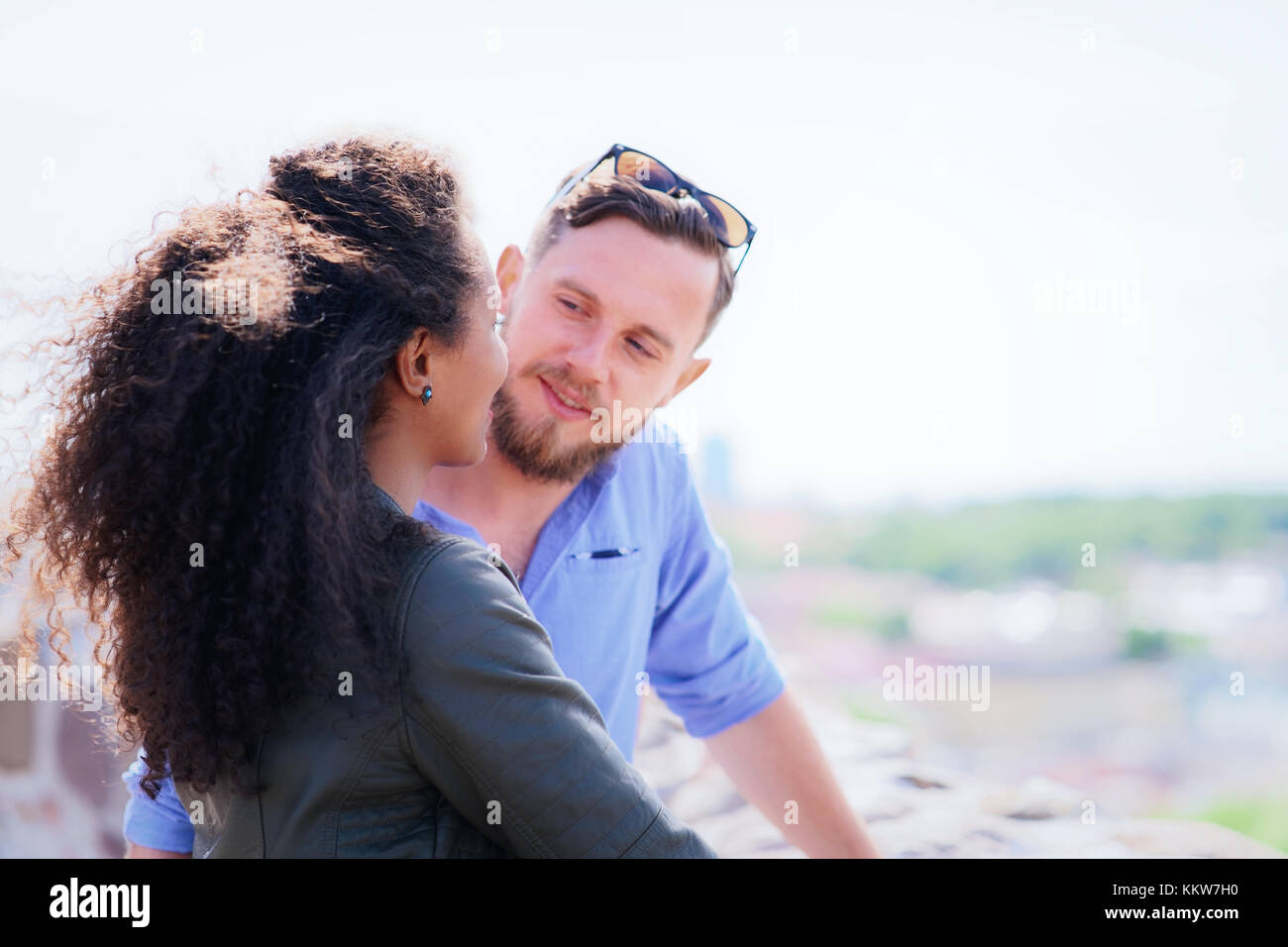 Young multiracial couple dating when Dutch man is looking tenderly at his beautiful arabic girlfriend as diversity - Stock Image