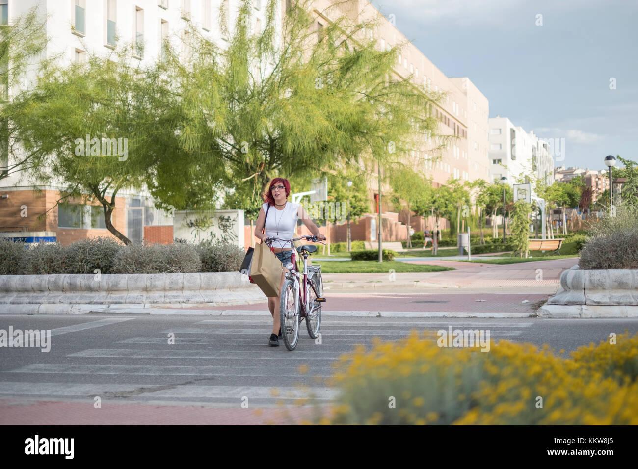 Woman with bike lifestyle on european little city of jaen - Stock Image