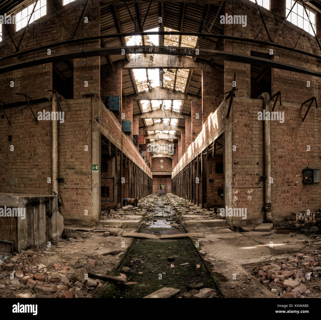 Interior of abandoned factory, central perspective - Stock Image