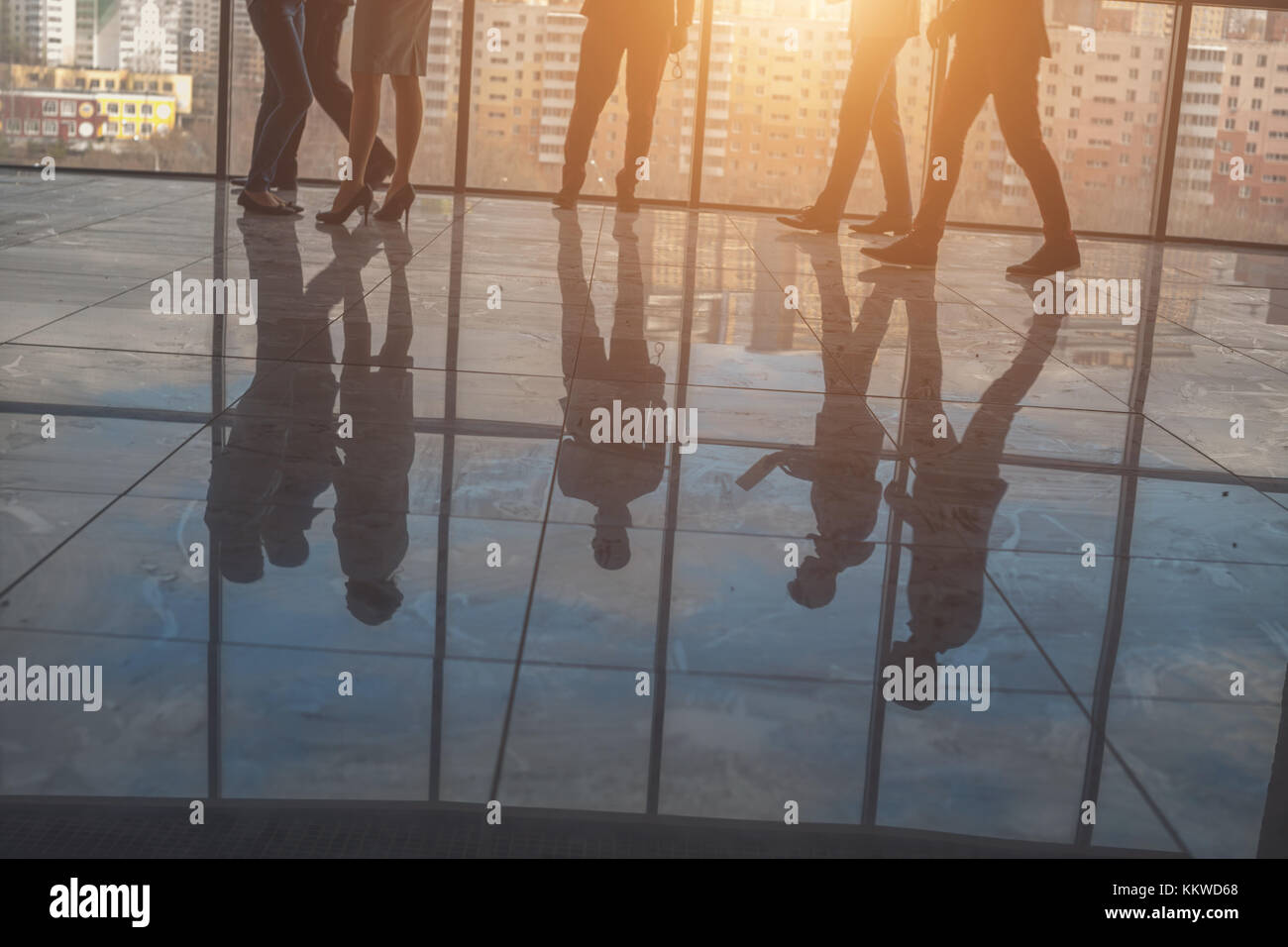 Silhouettes of business people in conference room - Stock Image