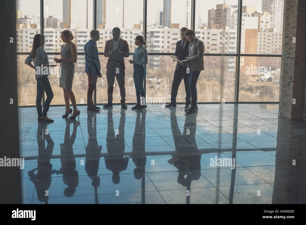 Silhouettes of business people in conference room Stock Photo
