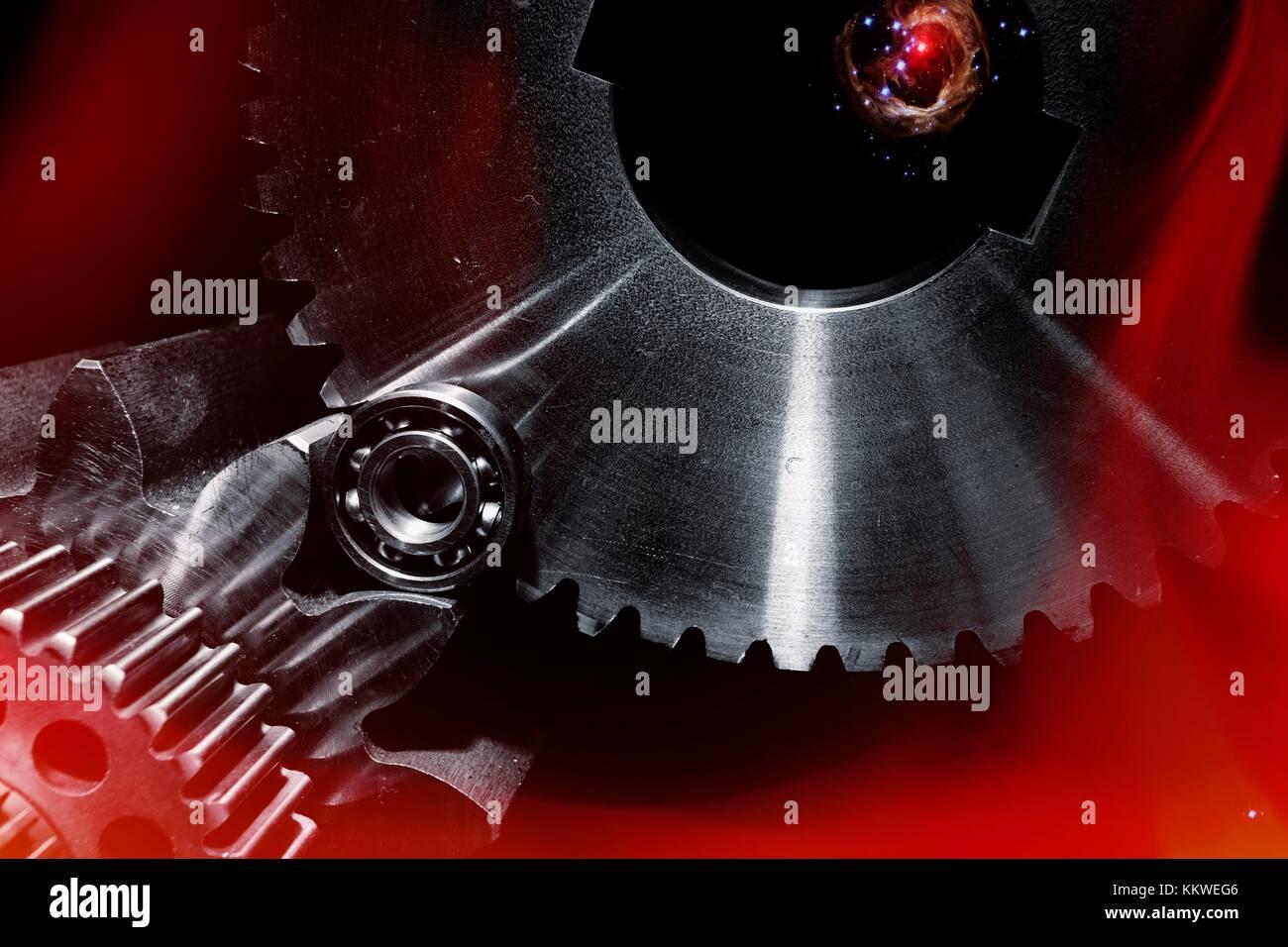 Titanium aerospace gears, conceptual composite image. - Stock Image