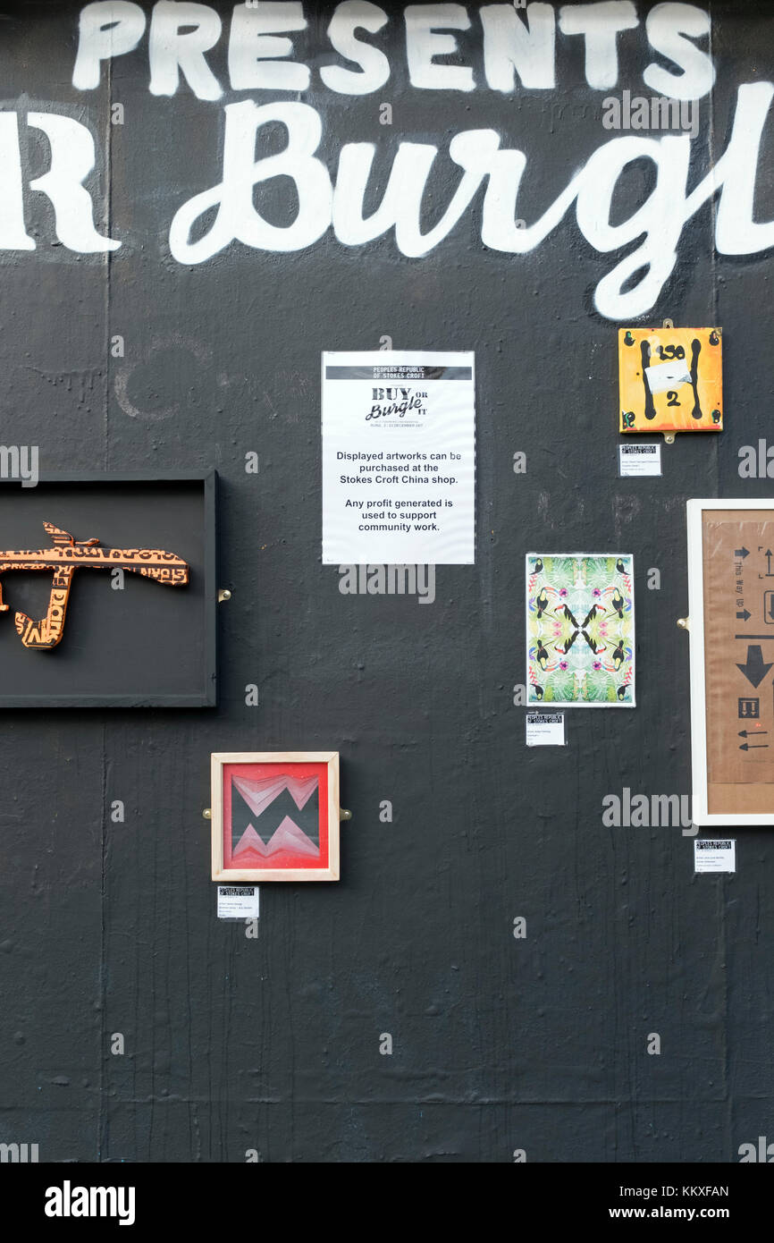 Bristol, UK. 2nd December, 2017. Artwork on sale at an outdoor exhibition in Stokes Croft. The exhibition, entitled - Stock Image