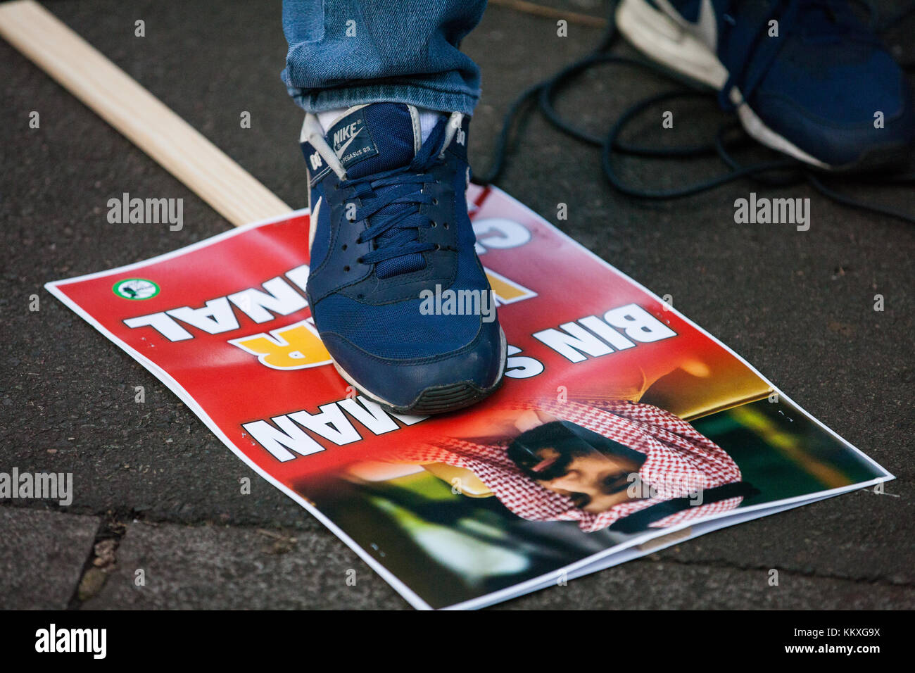 London, UK. 2nd December, 2017. An Arab demonstrator stands on an image of Mohammad bin Salman, Crown Prince of - Stock Image