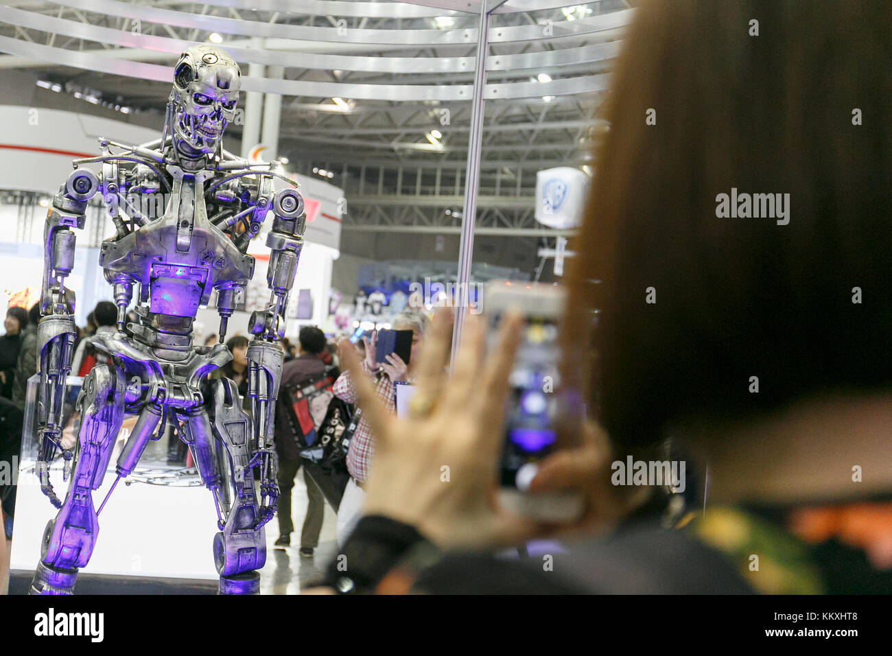 A visitor takes pictures of a life-size statue of Terminator Endoskeleton T-800 during the Tokyo Comic Con 2017 - Stock Image