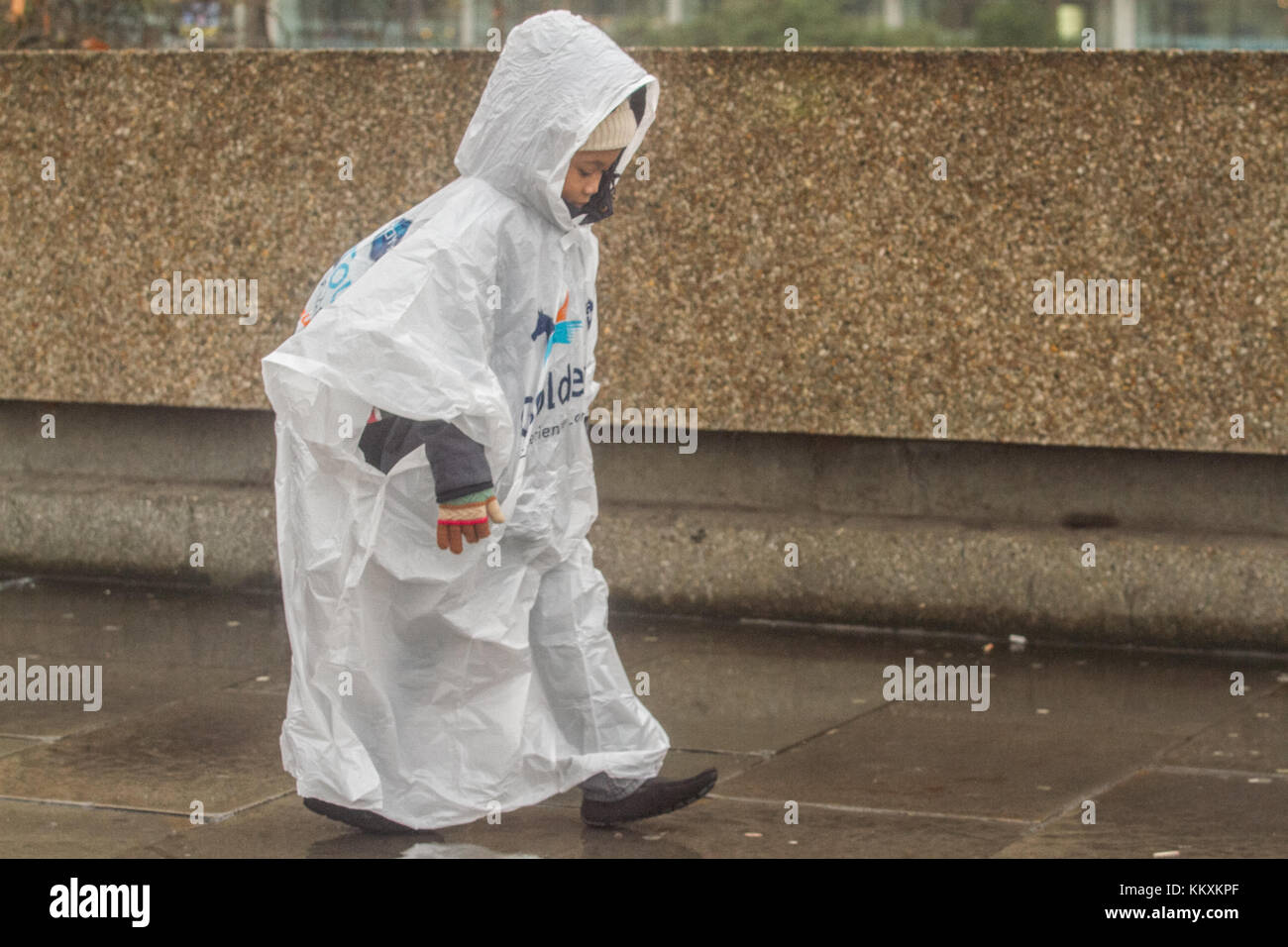 London, UK. 3rd Dec, 2017. Pedestrians wearing rain ponchos on Westminster on an ovecast wet day Credit: amer ghazzal/Alamy - Stock Image