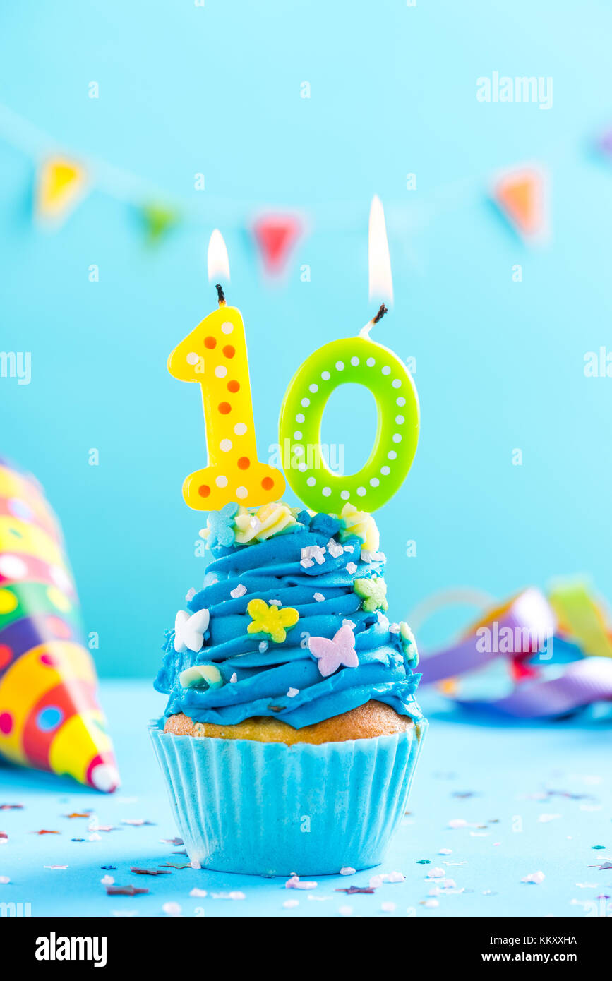 Tenth 10th birthday cupcake with candle and sprinkles. Card mockup. - Stock Image