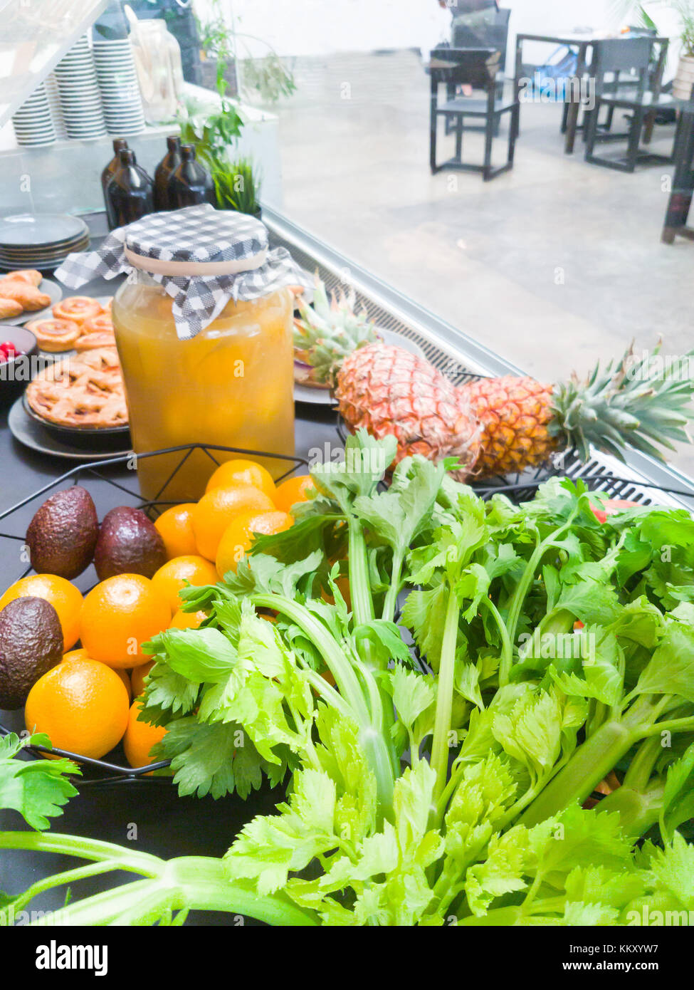 Contents of cafe chilled counter, fresh food,bakery items and fruit. - Stock Image