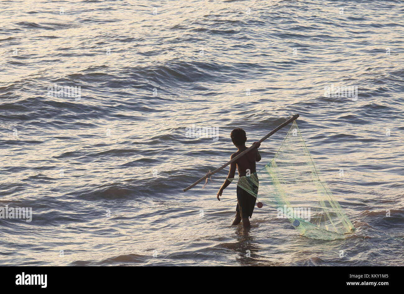 Indian child fisherman in Mumbai India - Stock Image