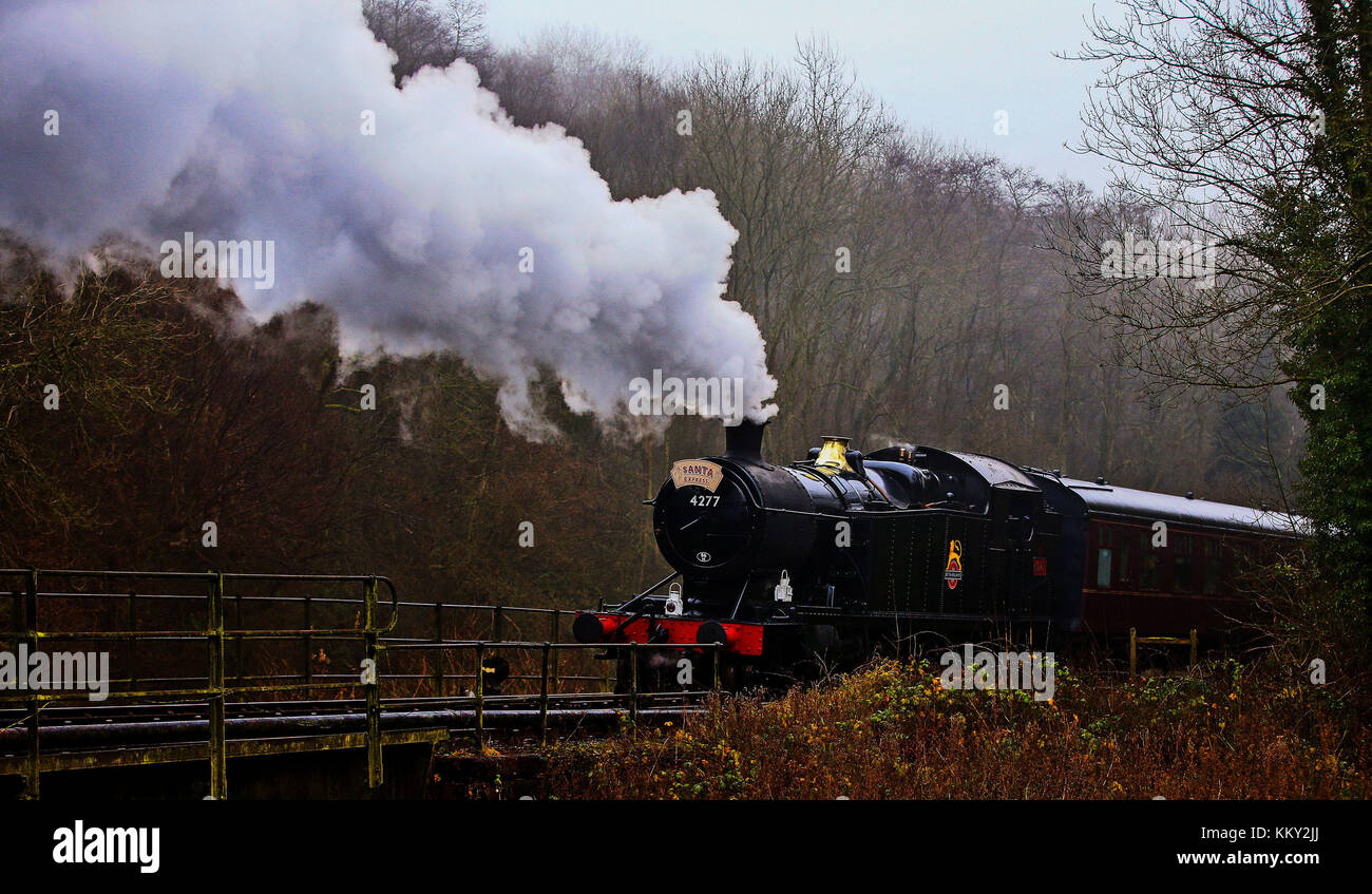 The Churnet Valley Railway Santa Train traveling between Chedderton Station in Staffordshire and Froghall Station. - Stock Image