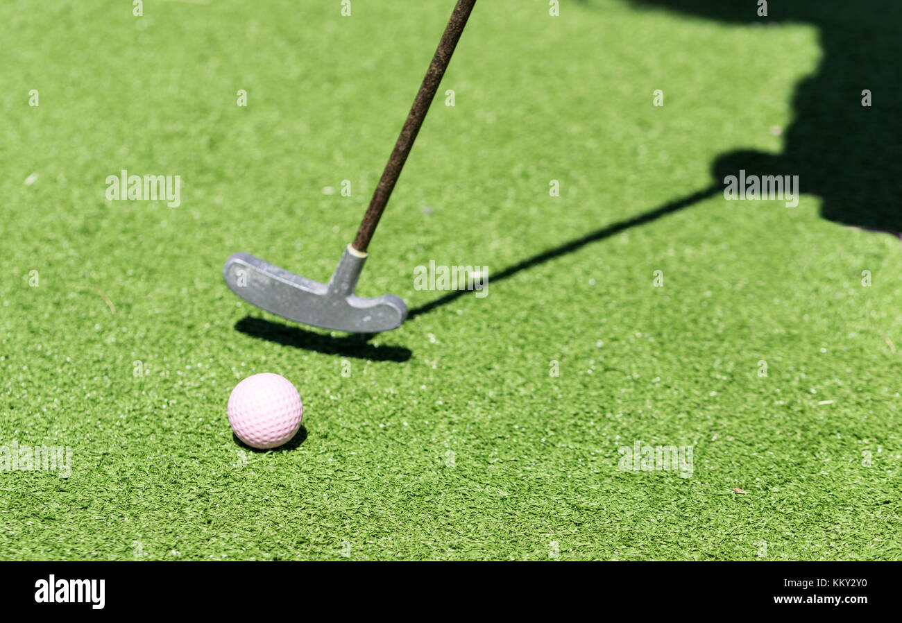 miniature golf racket and a shadow of the player - Stock Image