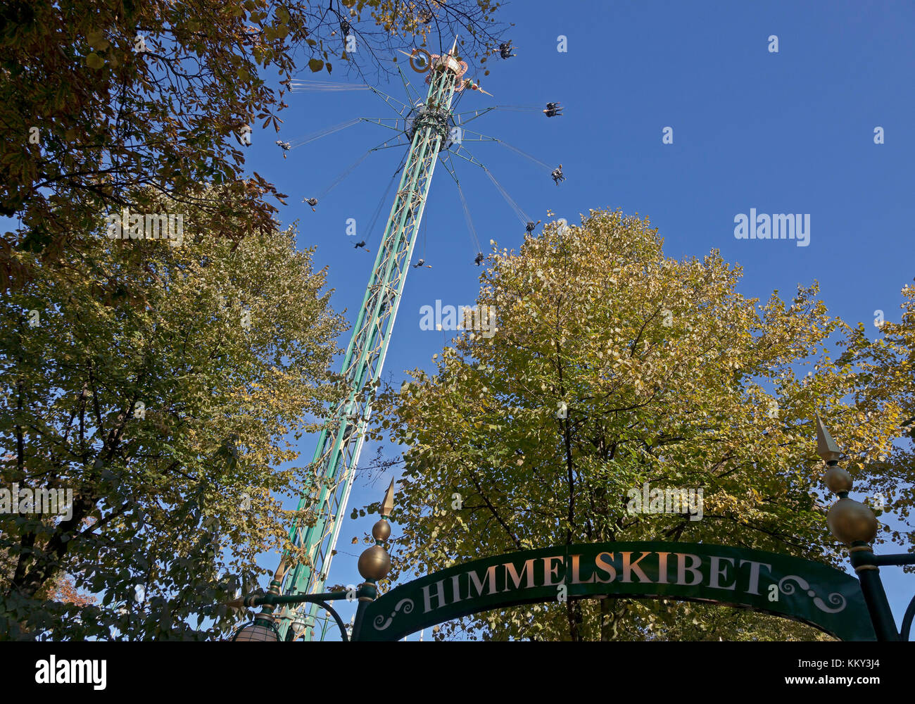 The Star Flyer, or Himmelskibet, in the Tivoli Gardens in the Halloween season. With 80 m the highest carousel in - Stock Image
