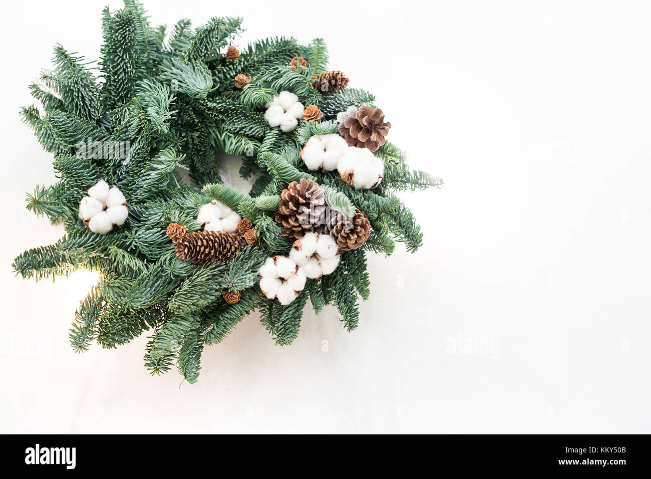 winter, crafting, nature concept. with negative space, lovely wreath made by talented floral designer with the use - Stock Image