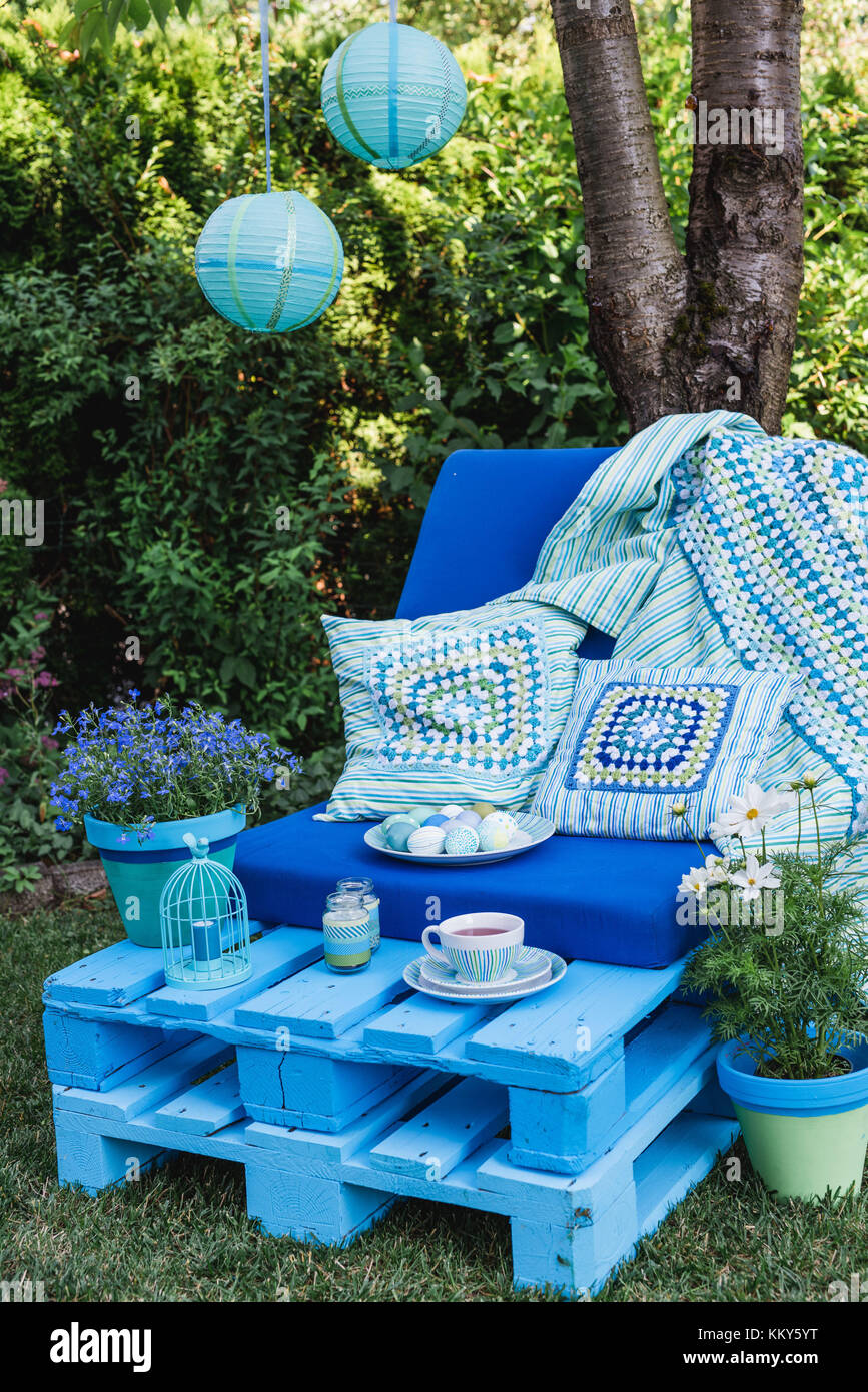 Garden, sofa made of pallets, Easter decoration, detail, flowers, - Stock Image