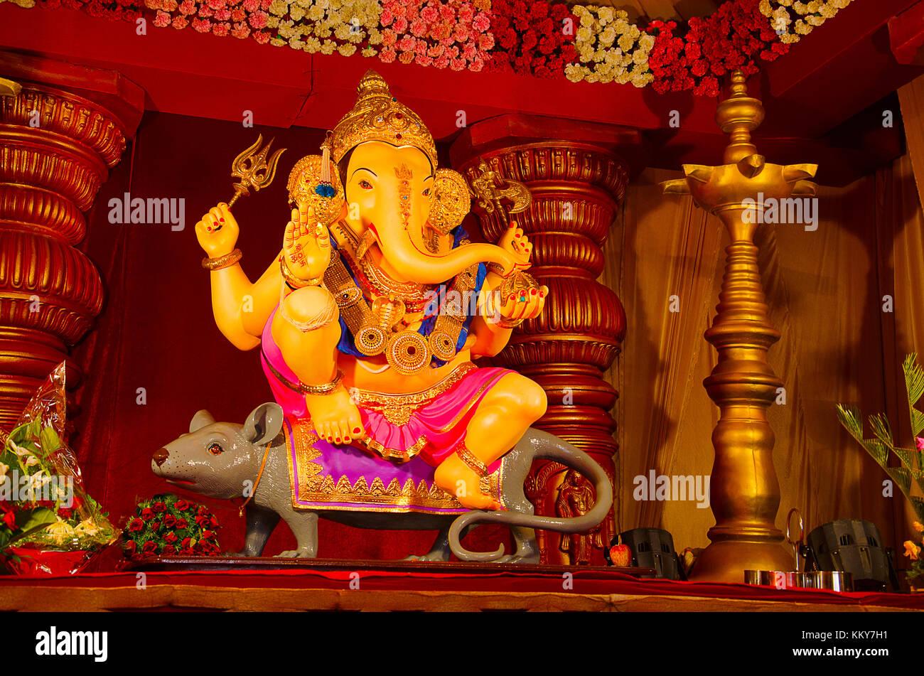 An Idol Of Lord Ganesha Sitting On His Vehicle