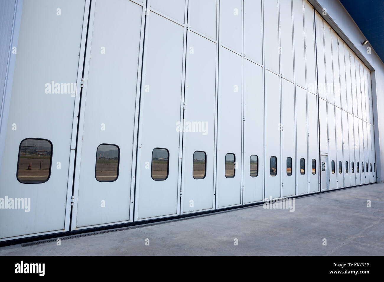 Airport hangar from the outside with big tall doors. Stock Photo
