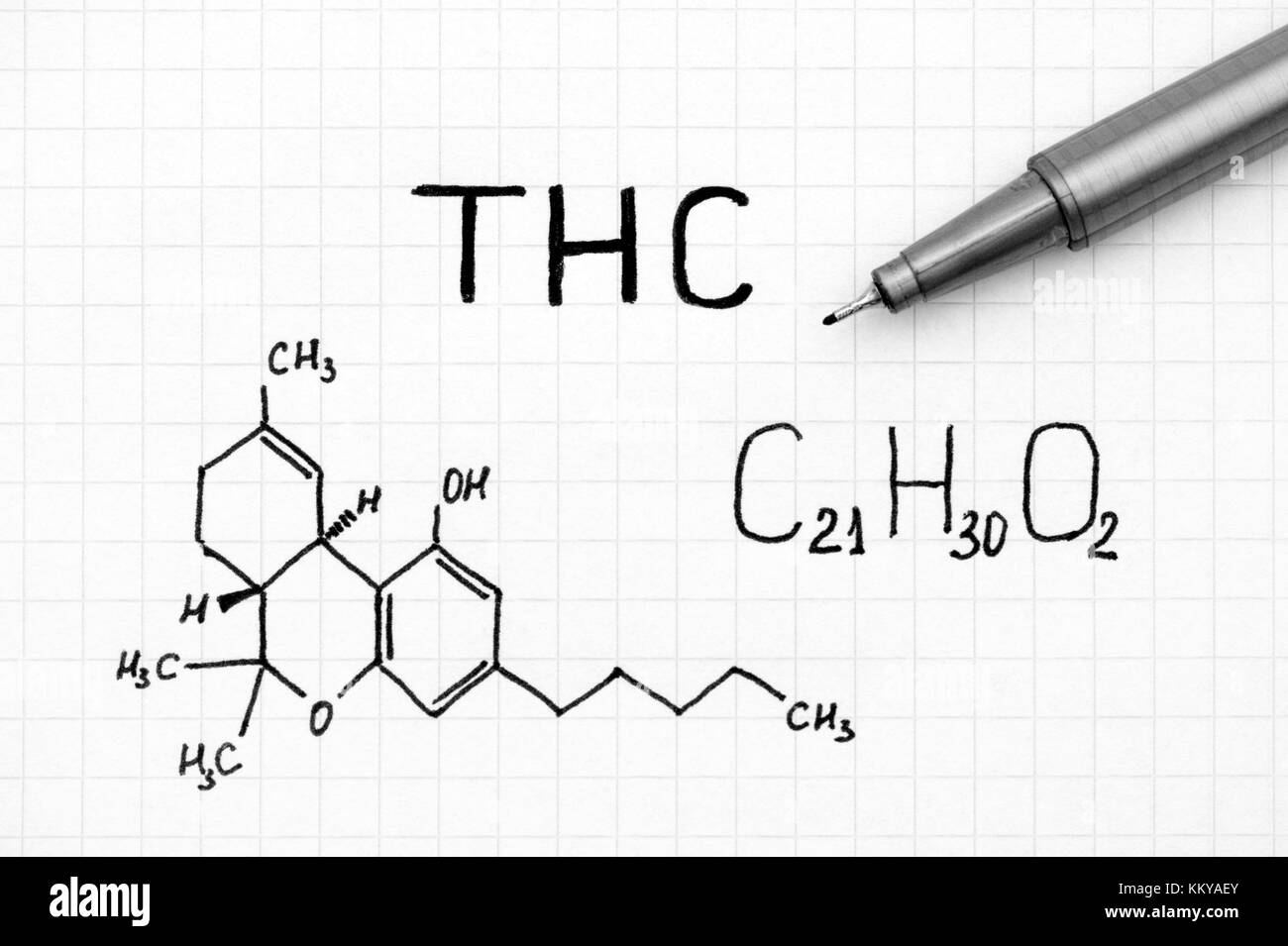 Chemical formula of Tetrahydrocannabinol (THC) with black pen. Close-up. Stock Photo