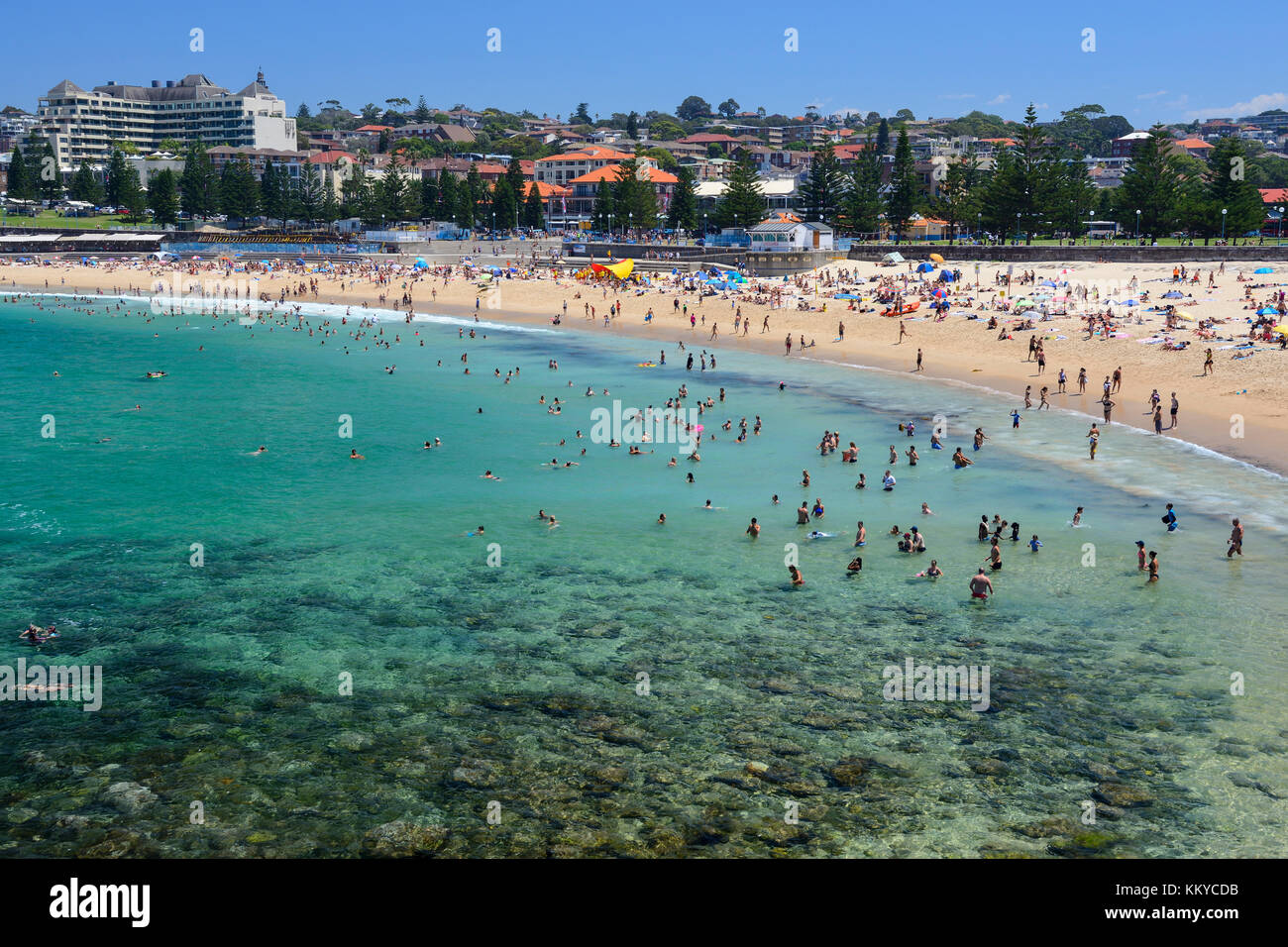 Sunbathers on Coogee Beach, Coogee, an eastern suburb of Sydney, New South Wales, Australia - Stock Image