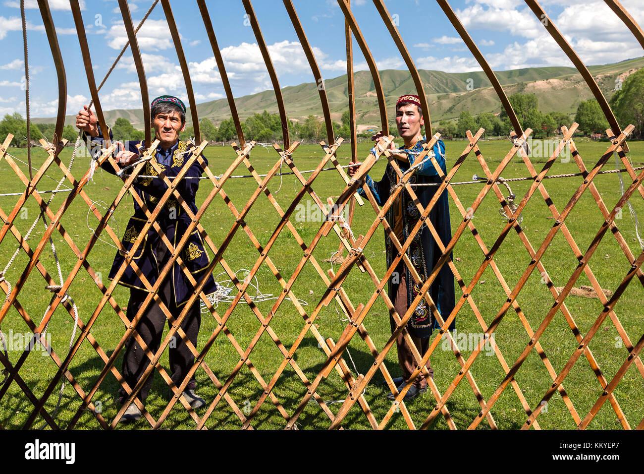 Kazakh people building a nomadic tent known as yurt, in Saty Village, Kazakhstan. - Stock Image