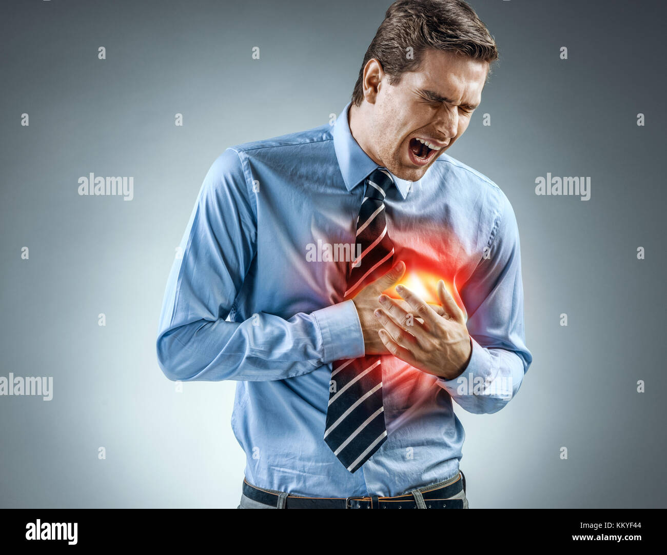 Office manager holding hands on painful chest. Medical concept. Heart attack. - Stock Image