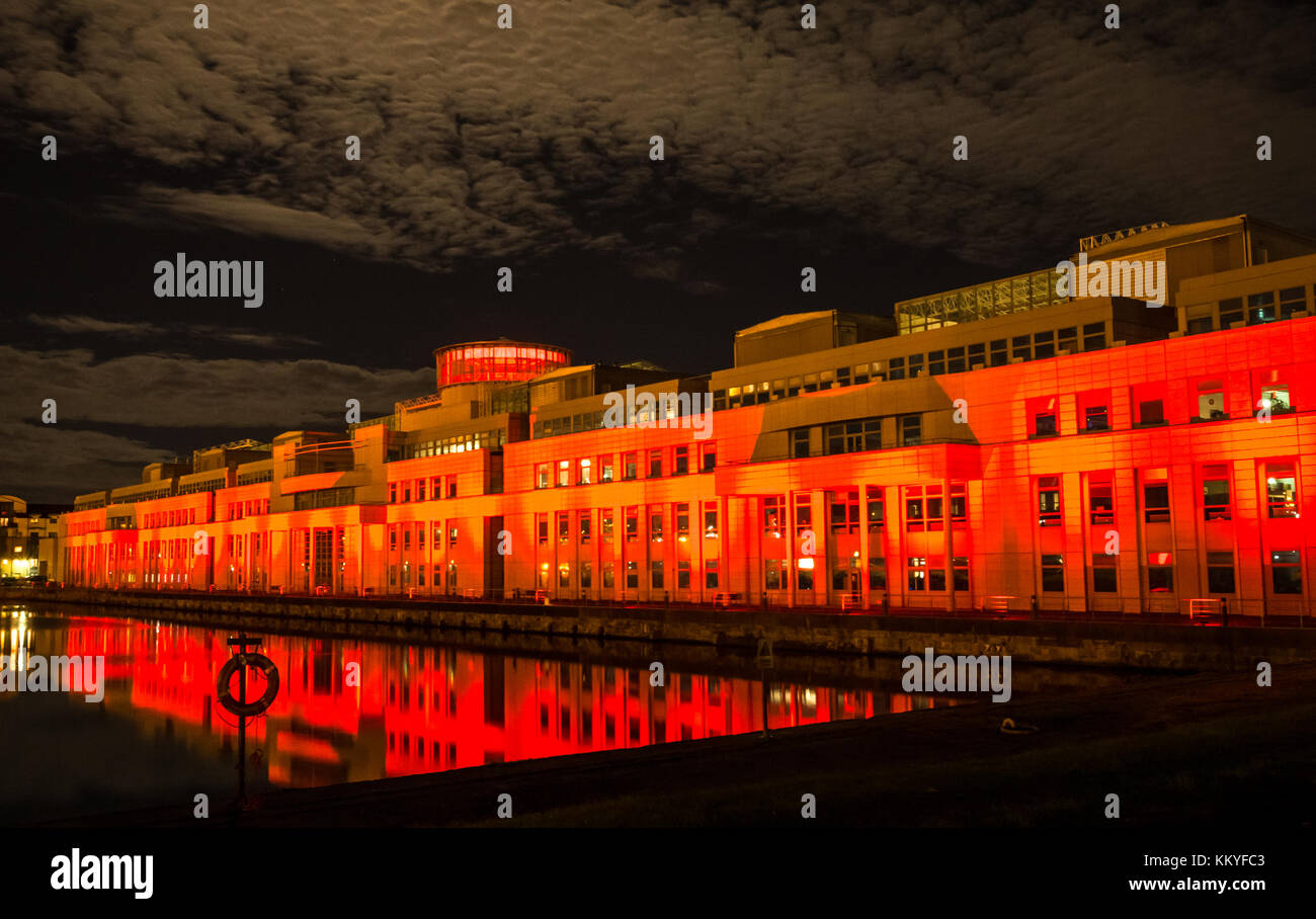 Scottish Government building Victoria Quay lit by dramatic red light, Poppy Scotland Remembrance Day commemoration, - Stock Image