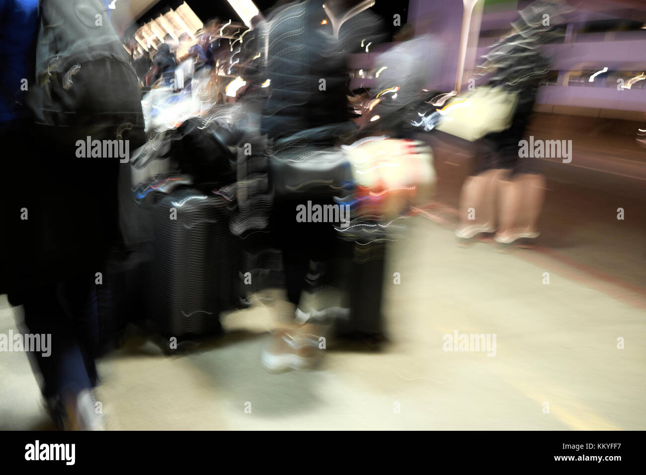 Blurred image of people waiting for pickup by an Uber taxi cab at LAX Los Angeles Airport California USA    KATHY - Stock Image