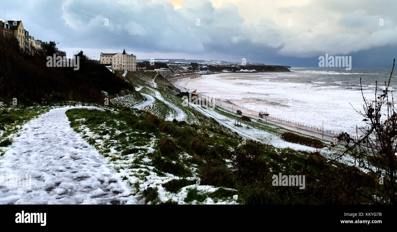 Scarborough North Bay under light snow, 30th November 2017 - Stock Image