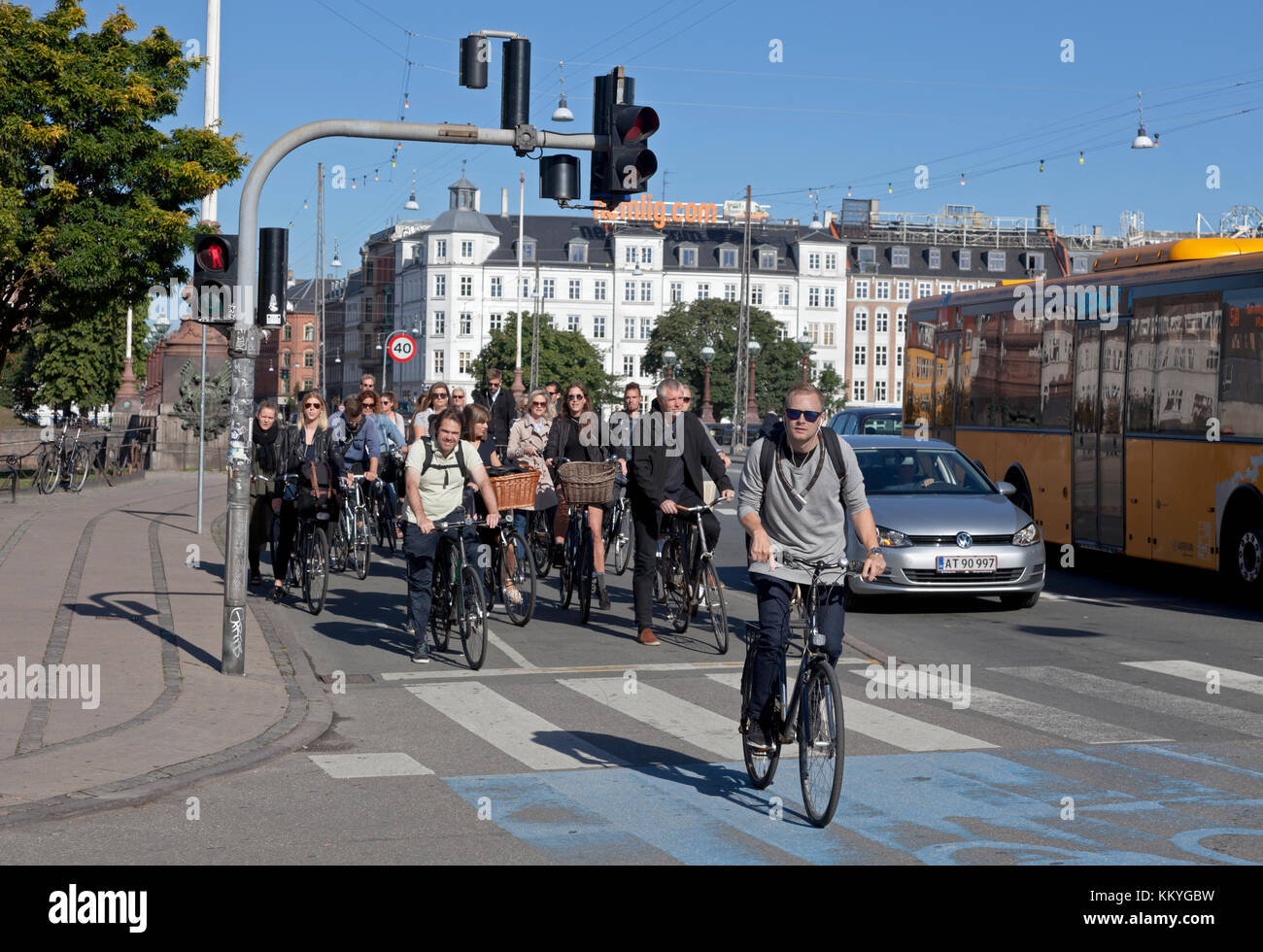 Summer late morning bicycle rush on bicycle path at the heavily bicycle-trafficked crossroads Frederiksborggade, - Stock Image