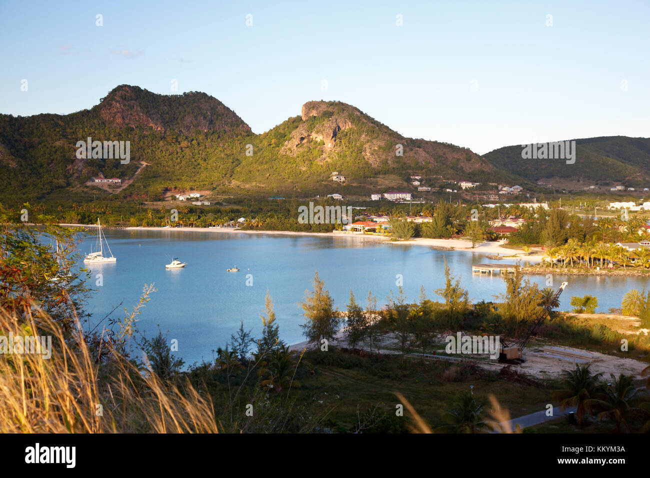Close to Jolly Harbor in Antigua. Sailboats in a bay in evening light. - Stock Image