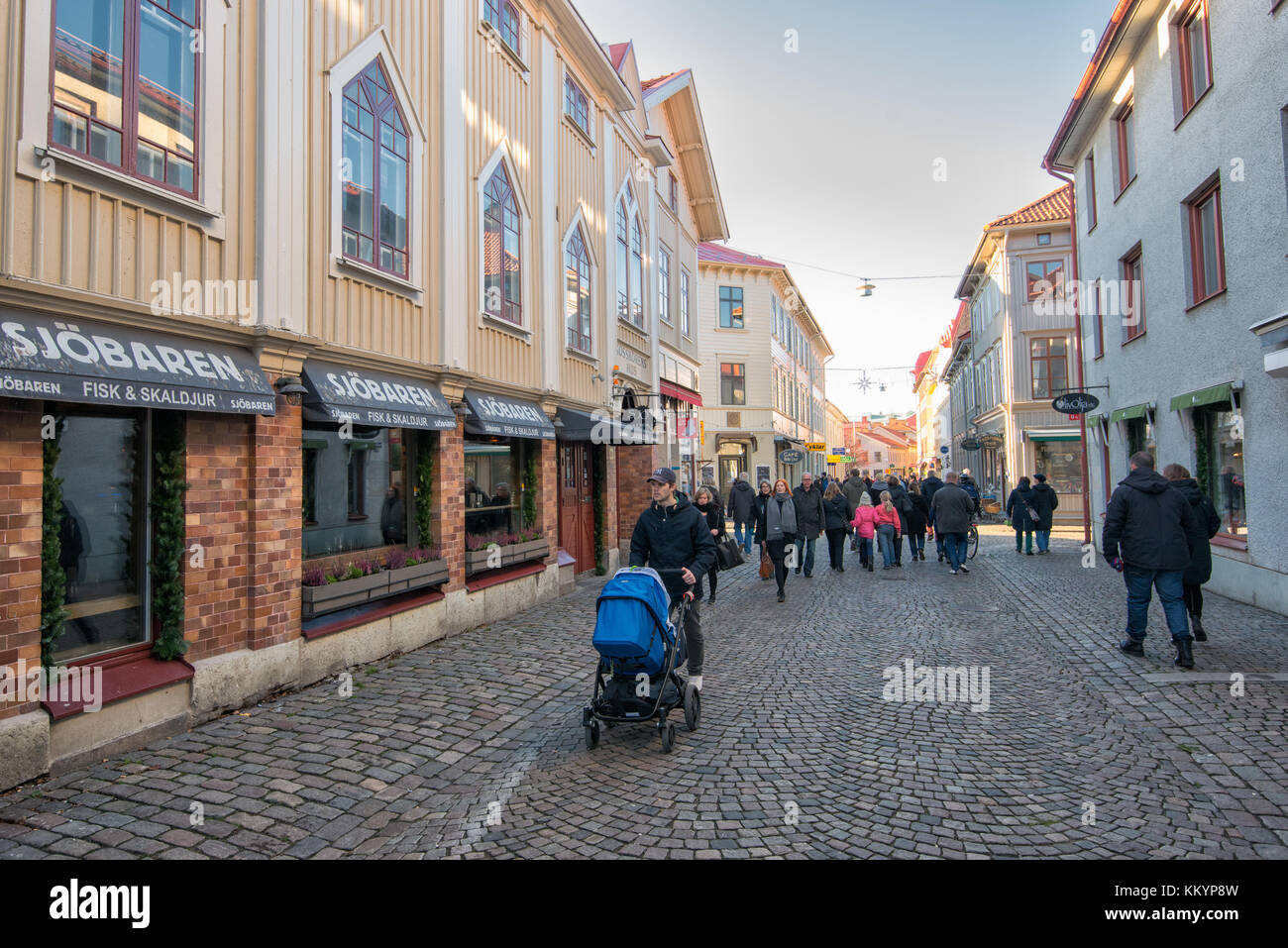 People stroll the streets of Haga in Gothenburg. Haga is a historic residential area, which has become fashionable Stock Photo