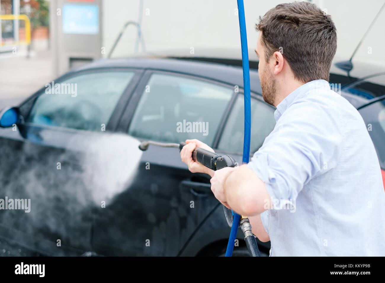 Man working car wash in stock photos man working car wash in stock man washing his car in a self service car wash station stock image solutioingenieria Images