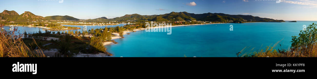 Panorama from a hill over Jolly Beach, Jolly Harbor and the eastern coast of Antigua. - Stock Image