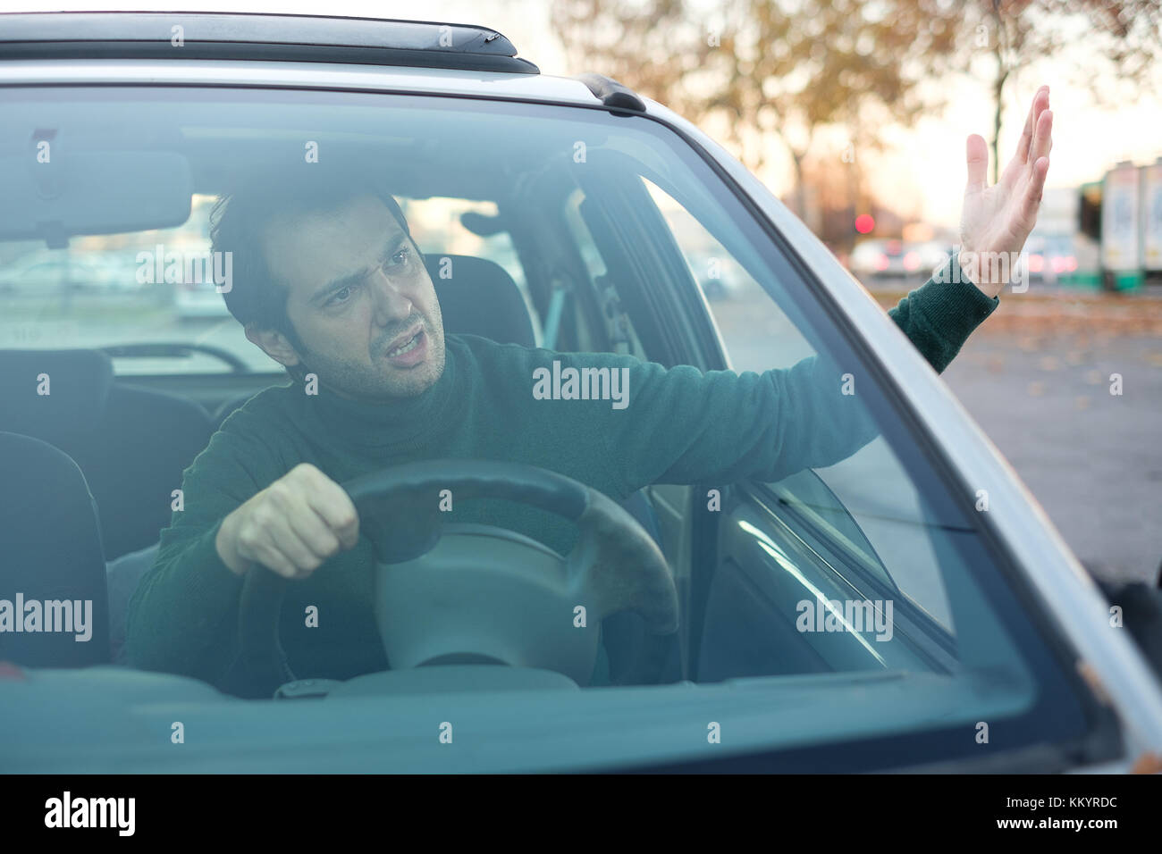 Closeup portrait of aggressive male driver honking in traffic jam - Stock Image