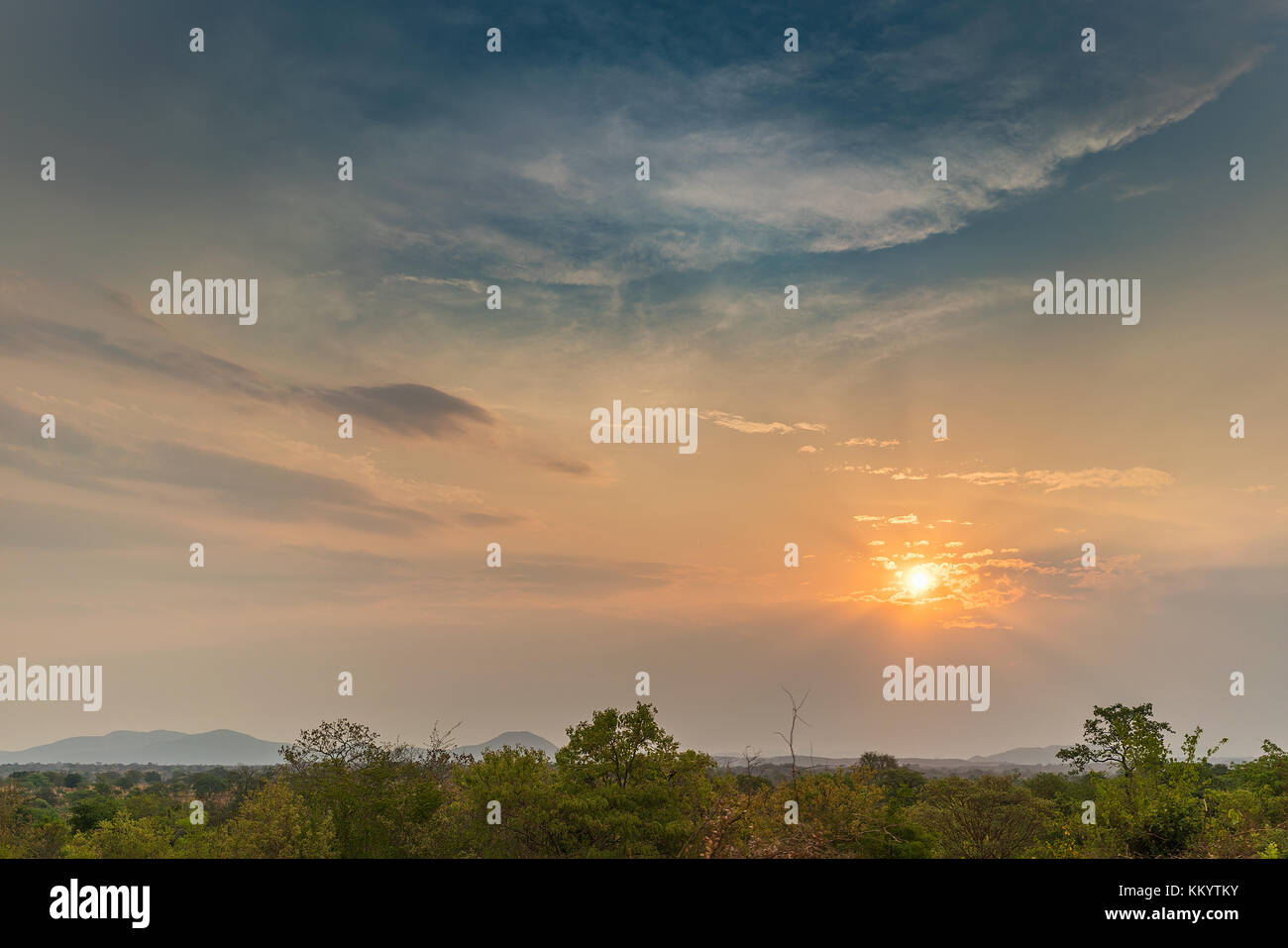 African landscape in Lubango, Angola with mountains and dramatic sunset. - Stock Image
