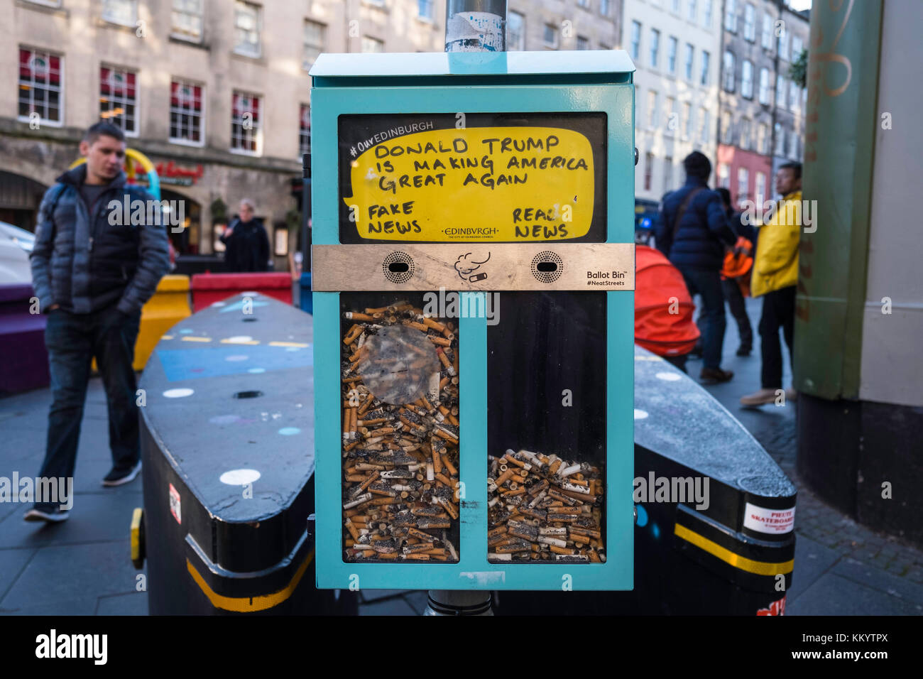Ballot Bin using cigarette butts/ends to allow voting on street on Royal Mile in Edinburgh, Scotland, United Kingdom - Stock Image