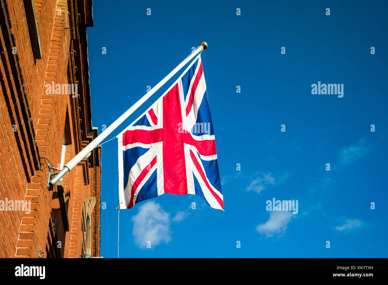 Union Jack flags hang from the King Edward VII Memorial Hall in Newmarket UK. The hall was donated to the town in - Stock Image