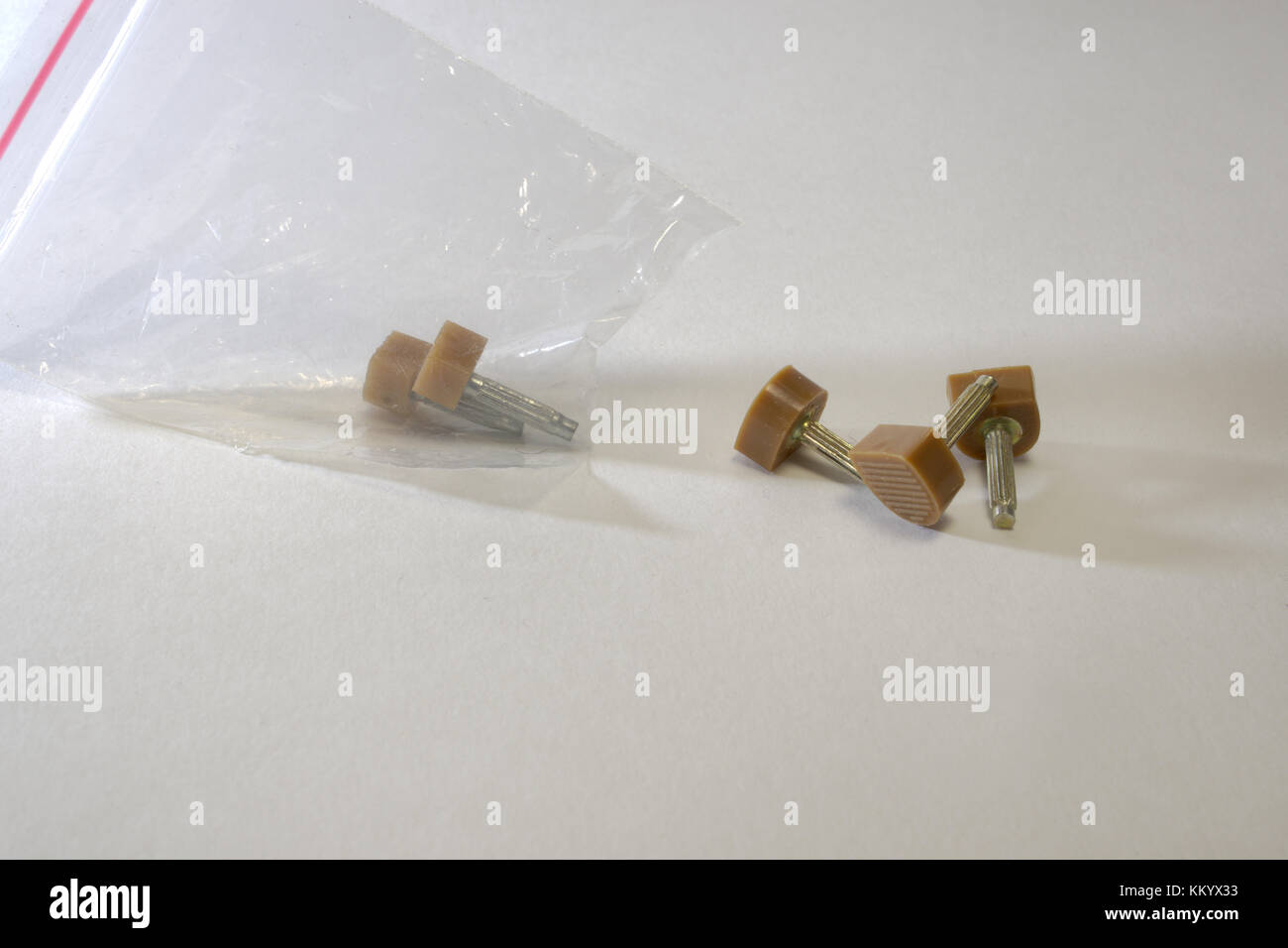 heeltap's Set for shoe with high heel on the dowel fasteners. in a transparent packet - Stock Image