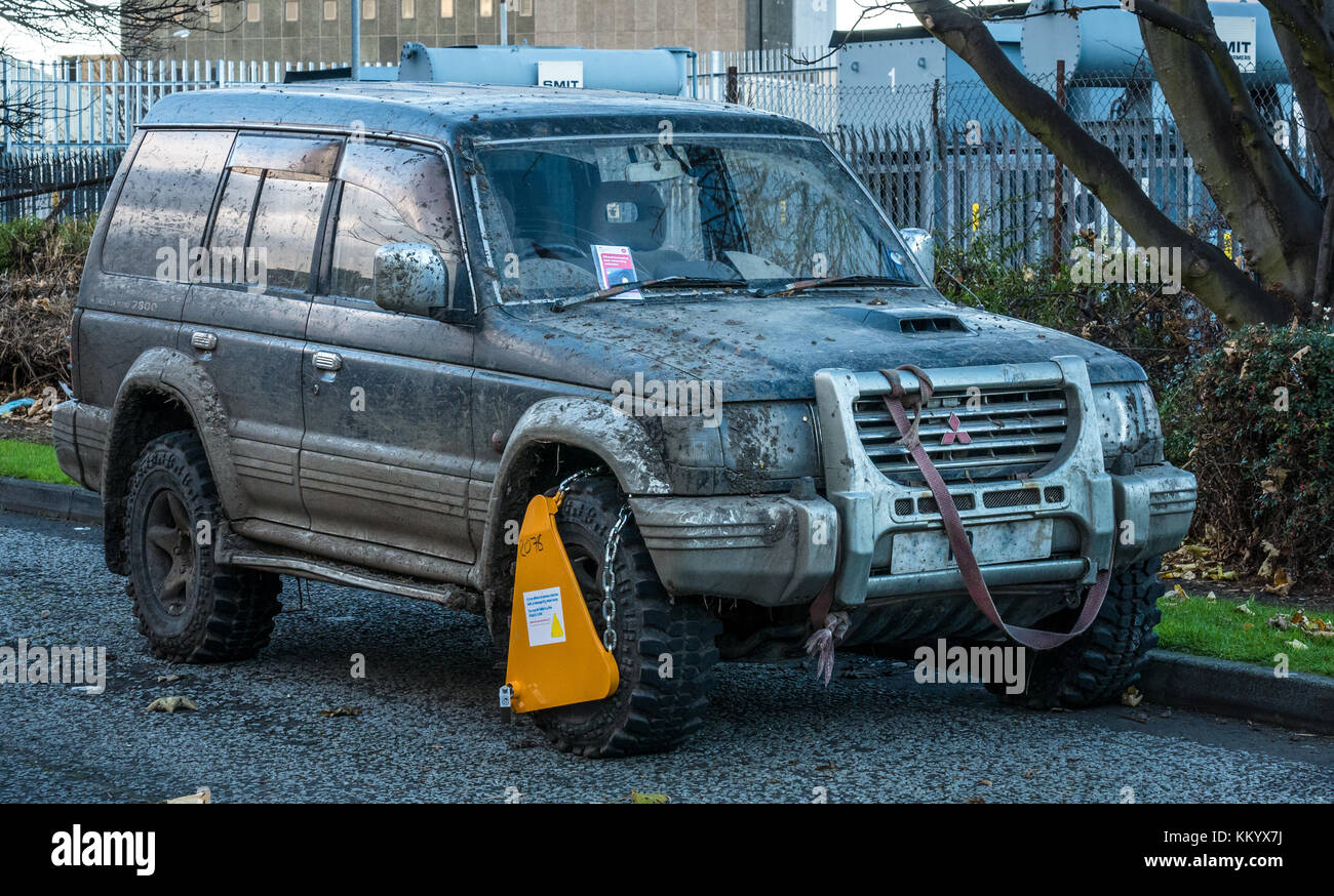 Mud splattered Mitsubishi Shogun 4x4 car impounded with