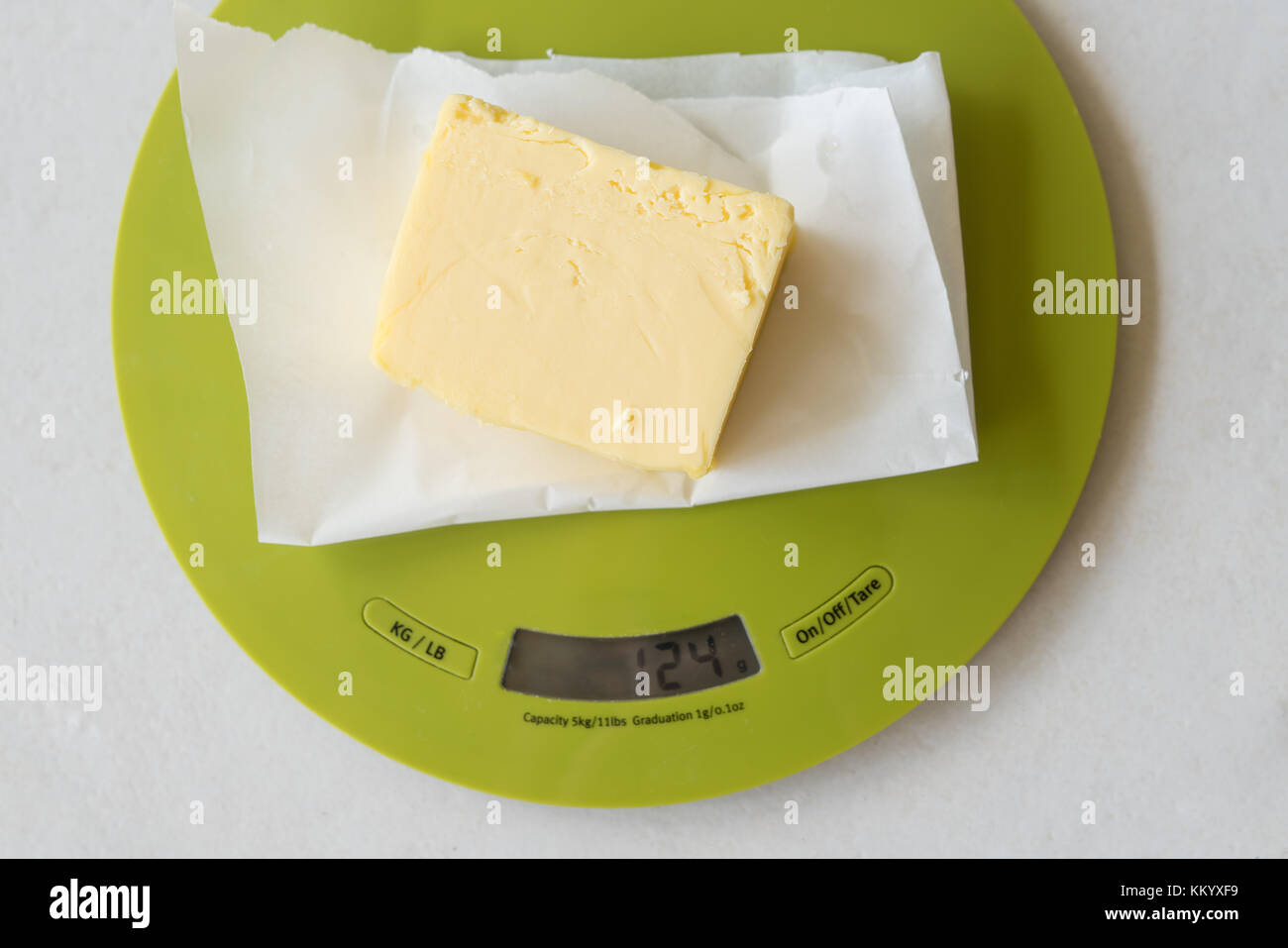 Weighting a stick of butter in preparation for cooking Stock Photo