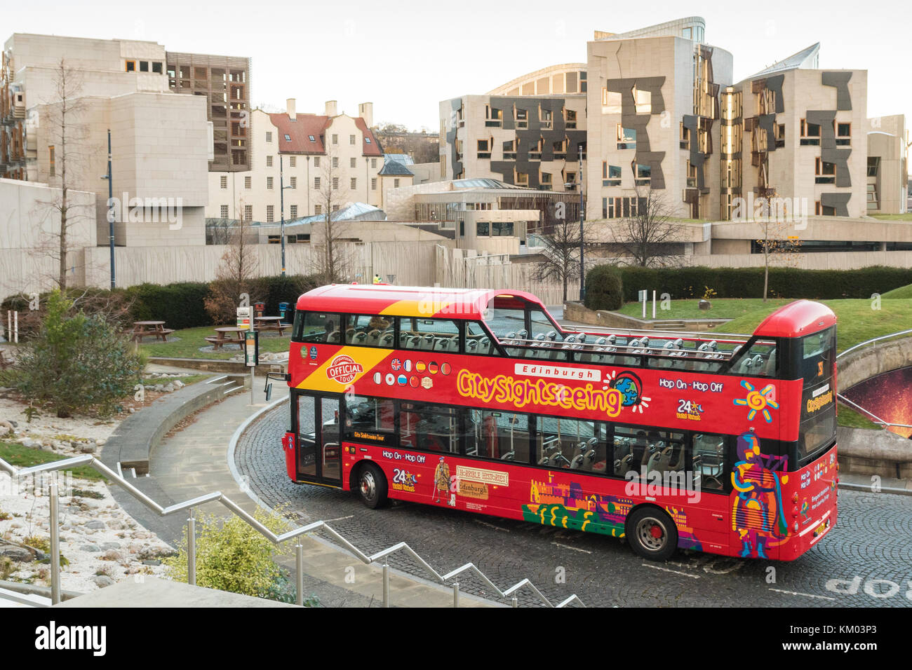 Edinburgh City Sightseeing tourist bus and Scottish Parliament Building, Edinburgh, Scotland, UK Stock Photo