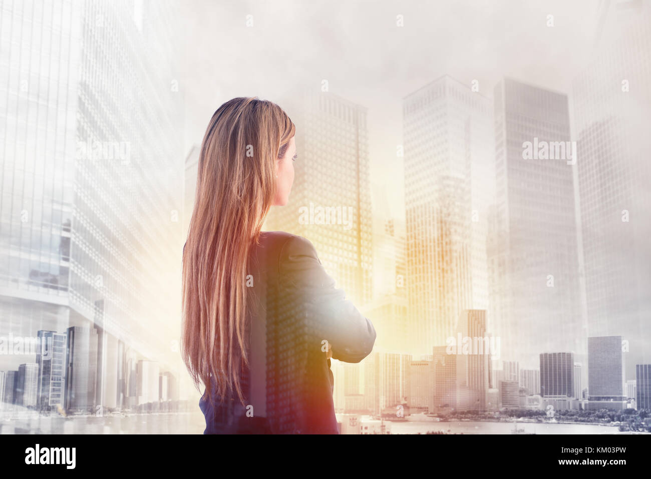 Businesswoman looks far for the future - Stock Image