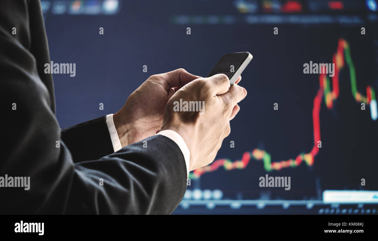 Businessman using mobile smart phone, raising graph background. Business growth, investment and invest in stock - Stock Image