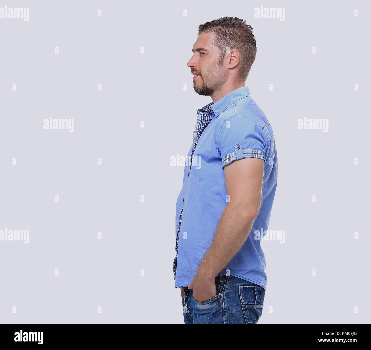 Full body of young man looking away isolated on white background - Stock Image
