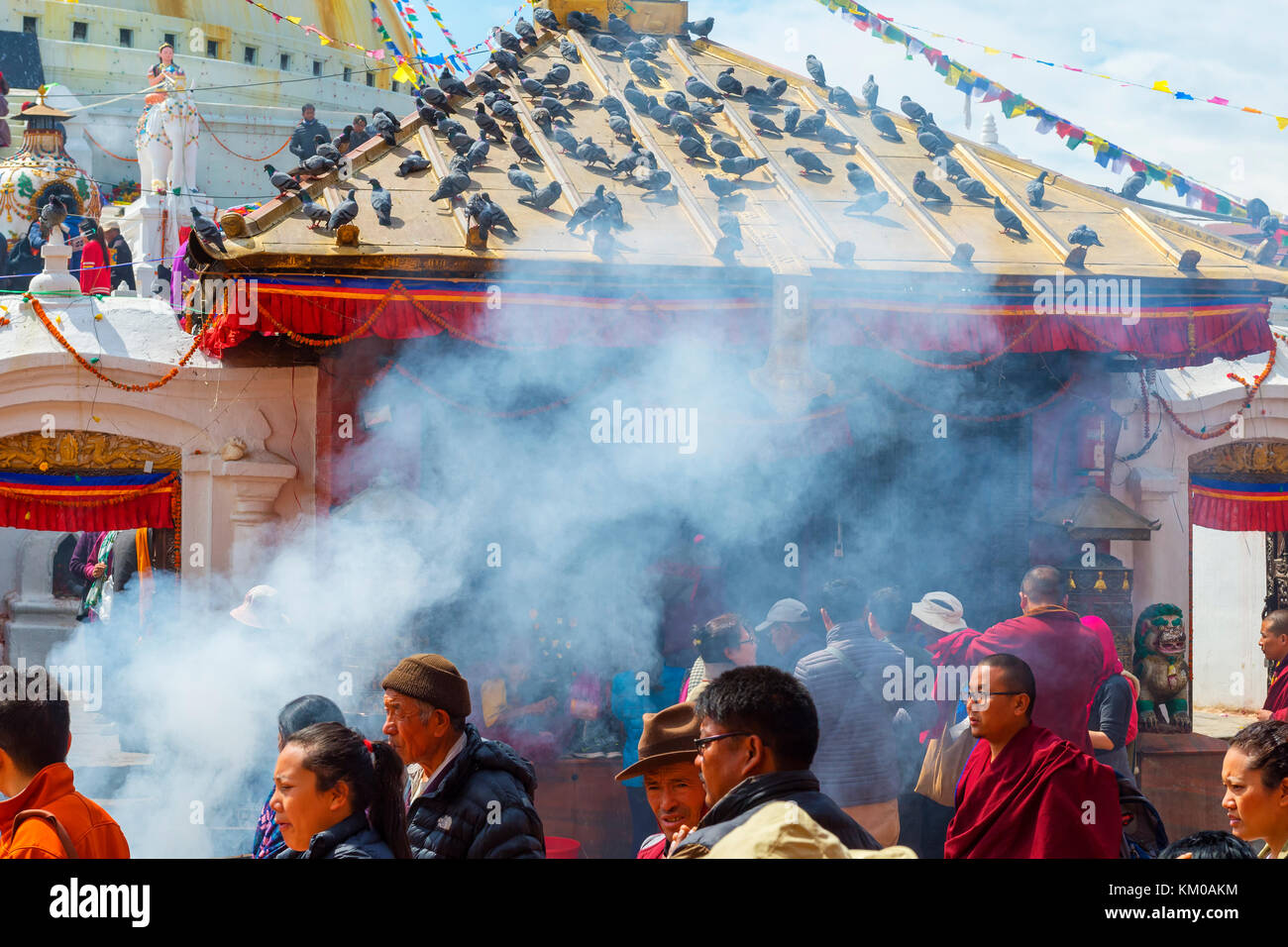 Buddhist pilgrims entering the Boudhanath Stupa, Largest Asian Stupa, Unesco World Heritage Site, Kathmandu, Nepal, Stock Photo