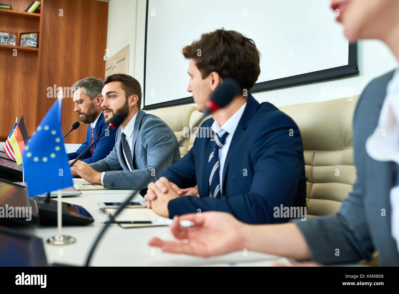 Discussing Topical Issues with Delegates - Stock Image