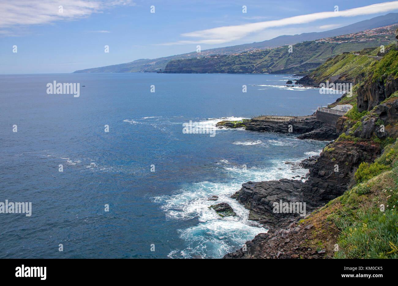 Rocky coast at Puerto de la Cruz, north side of Tenerife island, Canary islands, Spain - Stock Image