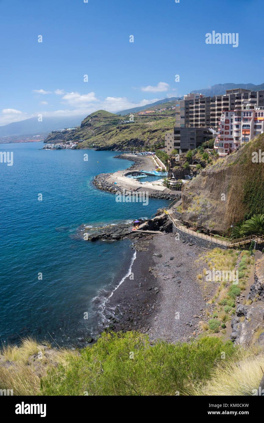 Tiny dark beach at a footh path between  Tabaiba and Radazul, Tenerife island, Canary islands, Spain - Stock Image